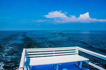 Stern seating to enjoy the view of the sea under blue sky.