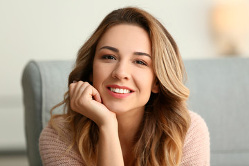 Portrait of beautiful young woman at home