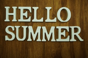 hello summer alphabet on wooden background