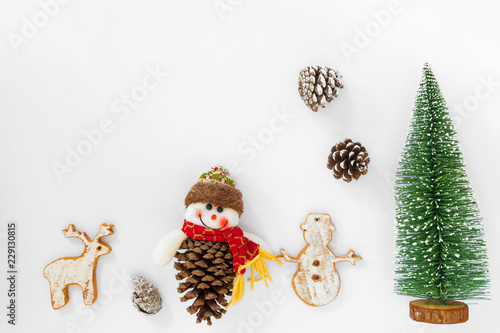 christmas and new year background christmas tree and pine cones with decoration on white paper