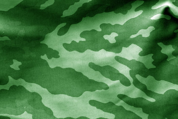 Camouflage cloth with blur effect in green tone.