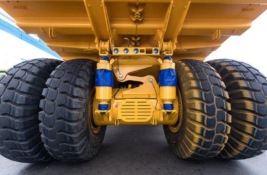 Huge wheels of a yellow dump truck