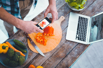 Kitchen table. Top view of the process of taking photos of food on a new innovative smartphone