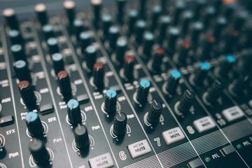 Digital sound audio mixer closeup . Equalizer console. Studio music recording equipment.
