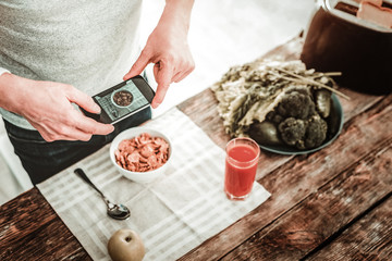 Food photography. Selective focus of a modern innovative smartphone being used for taking photos