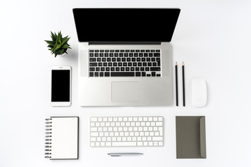 Office desktop with laptop and accessories