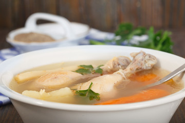 Homemade healthy Chicken clear noodle soup - broth. Hot chicken soup for cold and flu.