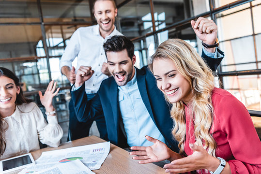 happy successful business team at workplace in office