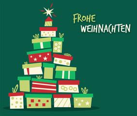 Weihnachtsbaum aus Geschenken Frohe Weihnachten gruener Hintergrund