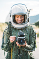 Girl wearing old space helmet with camera