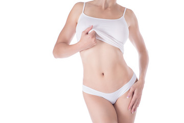 Female cropped fit body in white panties and top, isolated on white.