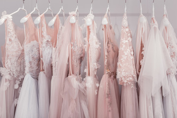 New design. Wedding dresses hanging together in the wedding boutique while waiting for someone to buy them