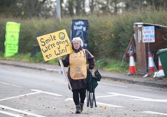 A protester stands outside Cuadrilla's Preston Road fracking site near Blackpool