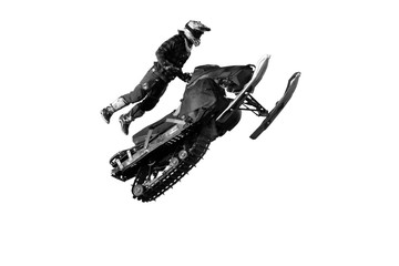 Freestyle motocross rider on snowmobile performs the trick in jump at fmx competitions (isolated on white background)