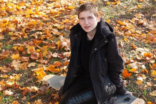 gender equality, girl in autumn Park, girl on a skateboard, LGBT concept,