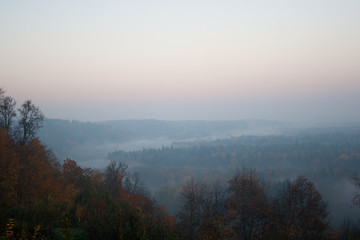 morning view on hills with forest in autumn day in Latvia