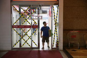 A glassdoor is seen taped, as it braced for super typhoon Maria in Taipei