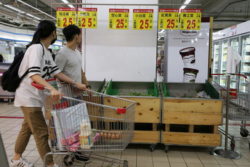 Vegetables are sold out at a supermarket, as residents brace themselves for super typhoon Maria in Taipei