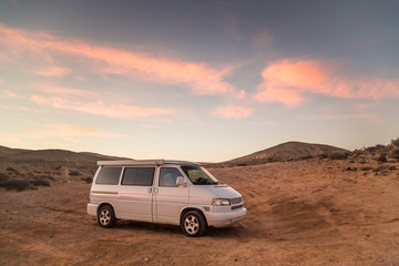 Family camper van parked on beach in Fuerteventura, Spain.