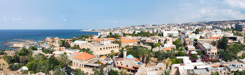 Zelfklevend Fotobehang Midden Oosten Byblos Lebanon - Panoramic view of the historic old buildings along the harbor