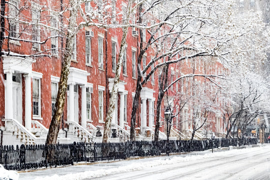 Snow covered sidewalks and buildings along Washington Square Park in Manhattan, New York City