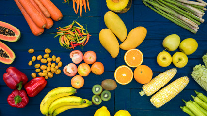 Flat lay of fresh  fruits and vegetables organic, Different fruits and vegetables for eating healthy, Colorful fruits and vegetables on blue plank background