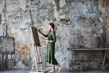 Woman painter in a green dress