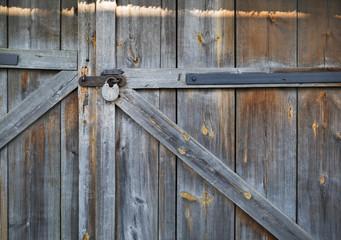 Old wooden gate. Vintage locked wood gates background.