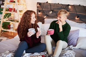 Two girls talking in bedroom