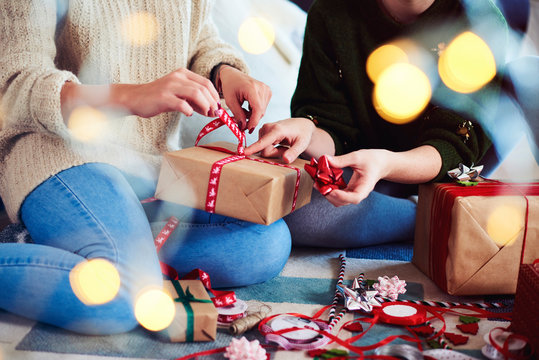 Two friends preparing christmas presents for Christmas