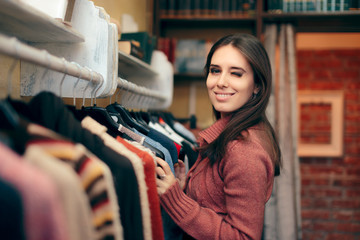 Beautiful Elegant Woman Checking out Sweaters in a Shop