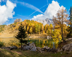 Colorful autumn morning in the mountains. Colourful autumn morning in mountain lake. Colorful autumn landscape.