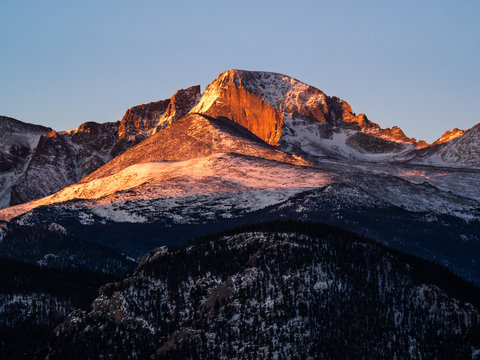 Longs Peak in the first rays of morning and with a light dusting of snow