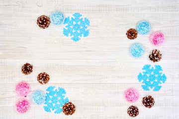 Festive composition of Christmas decorations on white wooden background.