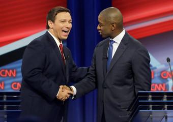 Florida Republican gubernatorial candidate DeSantis shakes hands with Democratic gubernatorial candidate Gillum after a CNN debate in Tampa