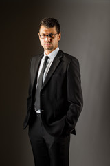 A serious man in a black suit.