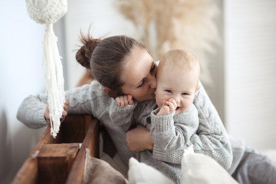 mom hugs charming baby,motherhood in real interior