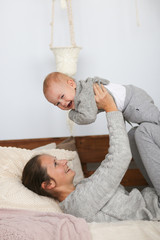 Mom and baby together in cozy interior, motherhood