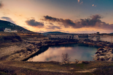 Lake on the site of a career in Inkerman at dawn, Kalamita fortress on the top, Sevastopol, Crimea, Russia