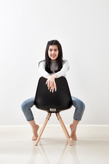 asian woman sitting on the chair