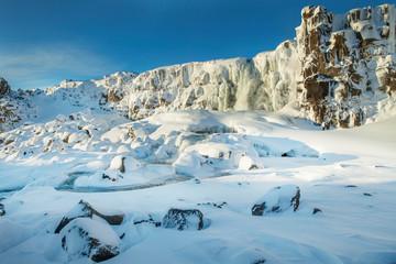 Öxarárfoss waterfall, Thingvellir national park, Iceland. Bright and sunny day with cobalt blue sky