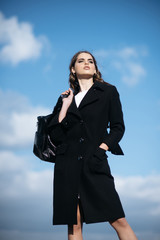 Pretty girl with fashionable hair. Fashion woman with stylish makeup and curly hair. autumn fashion of business woman with bag. Beauty and fashion look. She got great style. Looking trendy
