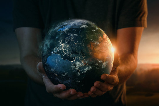 Planet earth in human hands. Elements of this image furnished by NASA