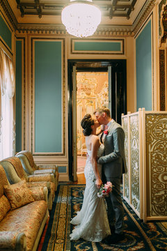 Registry office in St. Petersburg. Couple before the wedding on the stairs. Vintage style and historical architecture.