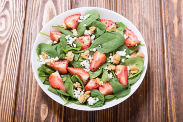 Strawberry salad with spinach , cheese and walnut
