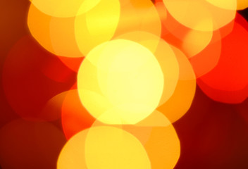Abstract Orange And Red Bokeh Background. Blurred Lights Flares.