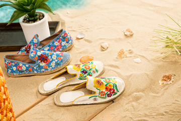 Espadrilles on Beach Sands Background