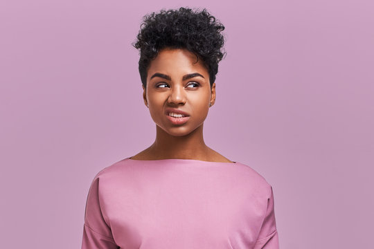 I hate you! Depressed stressful African American female clenched teeth, feels anger because of much work and duties about house, fed up with everything, has quarrel with enemy, poses indoor