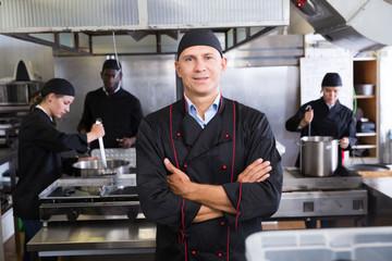 Professional chef in kitchen of restaurant
