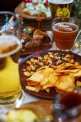 Delicious snacks for beer. Crispy chips with nuts